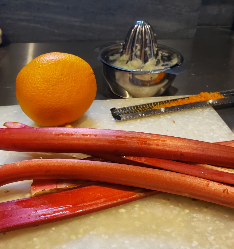 Orange, orange zester, Rhubarb stalks and stainless steel hand juicer